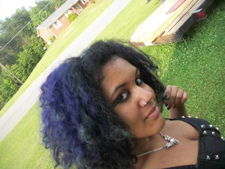 [image: mixed goth with curly black and purple hair and black and white eye makeup]