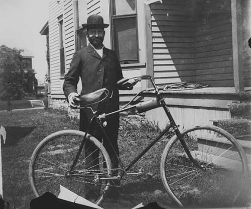 "afrormosia:  ""Man with bicycle.""Photographer: Guy M. Baltuff, ca. 1895 Location no. GV3.81 p31 Negative no. 38195  (Minnesota Historical Society Visual Resources Database)"