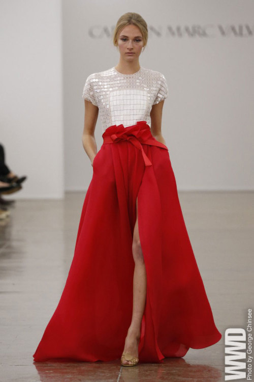 womensweardaily:  Carmen Marc Valvo RTW Spring 2013 The designer went all-out for his fans this season with oversize peplums and ruffles, blazing colors and glitter galore.  For More See all of WWD.com's RTW Spring 2013 Runway Coverage