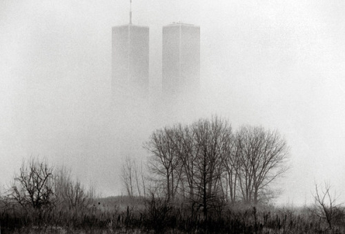 adanvc: The twin towers of the World Trade Center seen through fog from Liberty State Park in Jersey City, N.J.,Dec 31, 1994. by Keith Meyers