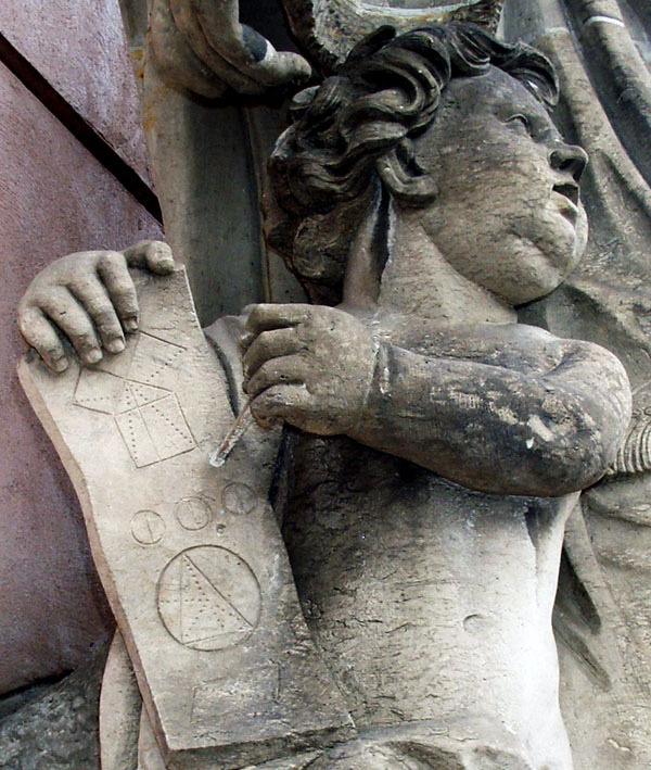 "This statuary is located at the entrance to the German Historical Museum in Berlin. The tablet contains the ""Bride's Chair diagram"" for proving the ""Pythagorean Theorem"" and the diagram used for constructing the circumcenter of a triangle. Photo by Charles F. Marion."