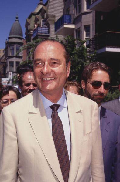 "According to FY Jacques Chirac, here is the former president of France in 1992. He appears to be in Montreal: if the architecture isn't a give away, the ""à louer"" sign is for sure. According to a Plateau Mont-Royal document that now only exists as a google webcache, he came here around that time to inaugurate this monument to Charles de Gaulle on Sherbrooke Street East, a gift from the City of Paris to Montreal on the occasion of the 350th anniversary of the city's foundation. Chirac was a protégé of de Gaulle and (obviously) a member of the same political family. I have to admit, I've walked past it a million times and had no idea what it was (and even less curiosity to find out.) The Union Gaulliste de France puts it very diplomatically: Il est légitime de se demander si l'art abstrait n'avait pas ses limites dans la représentation du témoignage de respect, d'admiration et de reconnaissance, surtout quand on parle de l'art public.  ""It is legitimate to question whether or not abstract art is limited with regards to the expression of respect, admiration and recognition, especially when it appears as public art."" Of course, the purpose of the monument may have intentionally been obscured for political reasons. Charles de Gaulle is a very controversial figure in terms of the relations between France and Canada, having declared in 1967, from no less of a pulpit than the balcony of the city hall of the country's largest metropolis ""Vive le Québec libre!"" (To which of course Prime Minister Pearson retorted ""Canadians do not need to be liberated."")  Ever since that incident, the Government of France's official position on the issue has been ""non-interference, non-indifference."" As for Canadians' opinions on the question, 1992 was four years before the most recent sovereignty referendum…"