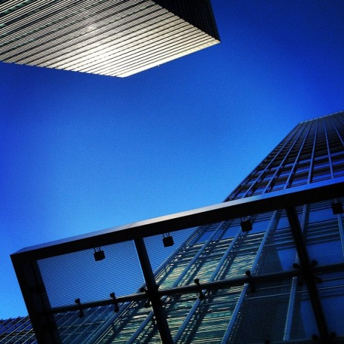 Sapphire Reflection • #bankstreet #canarywharf #eastlondon #londondocklands #london #england #greatbritain #unitedkingdom #nocloud #bluesky #steel #glass #overhang #canopy #sunlight #reflection #bright #25bankstreet #40bankstreet #up #evening #september #2012 #lofi #lux (Taken with Instagram at Canary Wharf Underground Station)