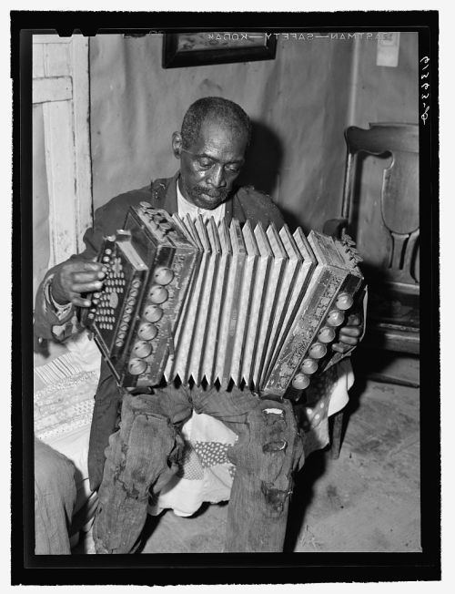 John Dyson, Farm Security Administration borrower, playing the accordion. Saint Mary's County, Maryland. [Dyson was in his 80s at the time this photograph was taken. He was born a slave.] September, 1940 John Vachon, photographer FSA/OWI Collection, Library of Congress