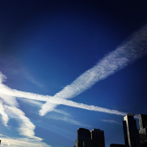 'X' marks the spot. Crazy clouds (or chemtrails?) over downtown Mpls. (Taken with Instagram at Ramp C Minneapolis)
