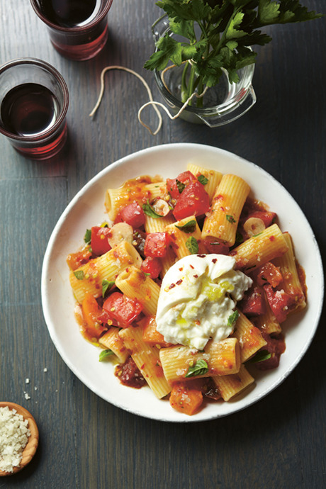 chroniclebooks:  Fresh Heirloom Tomato Sauce with Burrata, from Aida Mollenkamp's debut cookbook, Keys to the Kitchen. Difficulty: EasyYield: 4 to 6 servingsTotal prep time: 15 minutes, plus marinating timeHands-on time: 15 minutes So simple, but so delicious. The tomatoes, garlic, oil, and red pepper flakes create a brag-worthy sauce made sublime by the addition of creamy burrata cheese. TakeawayHow to make a no-cook pasta sauce. Good to KnowTop-quality tomatoes take this this dish from good or great so buy ones that are fresh, ripe, and in season.Burrata is a part cream, part mozzarella cheese that's pure indulgence. If you can't find it, buffalo mozzarella will work well.This dish also works well with any pasta that clings to the little puddles of sauce, like shell-shaped conchiglie or cup-shaped orrecchiette. Recipe Within a RecipeThe tomato mixture doubles as a bruschetta topping—just spoon over toasted country bread, drizzle with olive oil, sprinkle with salt, and serve. RiffsUse tangy cheeses like goat cheese or feta in place of the burrata.Add chopped capers, olives, sun-dried tomatoes, roasted bell peppers, or anchovies to the tomato mixture.Mix with homemade pesto (see book for recipe) for a chunky crossover sauce. (Read the full recipe on the Chronicle Books Blog)