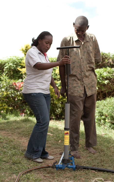 A sales representative shows a farmer in rural Kenya how to use an irrigation pump that can help him grow more crops and earn a higher income for his family. You can learn more too at www.theadventureproject.org.