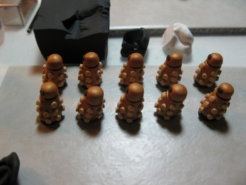 A peek at what I'm working on. Dalek charms at the moment. Originally planned to add two more colors to the red, silver and gold I already do but not enough time. Maybe for Anime Boston.
