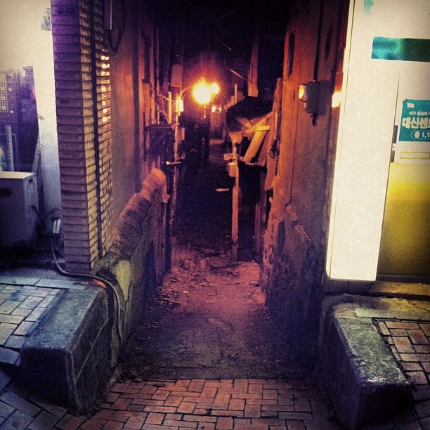 Knock turn alley? 😝 #daegu #dark #alley #side #road #narrow #korea #downtown #small #brick #night #odd #light #city #urban #cityscape #scruffy #dusty #old #wonky  (Taken with Instagram)