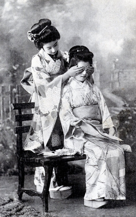 "Two Hangyoku (Young Geisha) from Tokyo playing a game of ""guess who?"", 1910s"