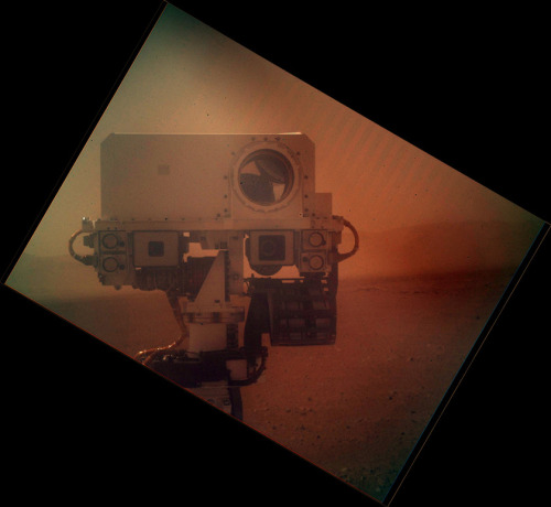 """Johnny Five is alive!"" jtotheizzoe:  Hello, beautiful! The Curiosity rover grabbed a special self-portrait last week. The Mars Hand Lens Imager (or MAHLI) is situated on the long arm used to gather samples. It turned around and snapped this shot of the mast head (the one that houses the cool laser-eye ChemCam) tinted via its dirty dust-cover. Well, Emily Lakdawalla at The Planetary Society has invited everybody to meme-ify it. I'd like to see what you come up with. Here's one from Matt Francis. I especially like this one that I made. Got a caption?"