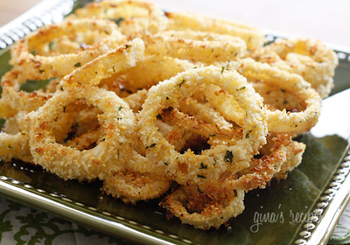 shedweightnottears:  mission—slimpossible:  Low Fat Baked Onion RingsAdapted from Life as a LofthouseGina's Weight Watcher RecipesServings: 2 • Serving Size: 1/2 • Old Points: 1 pt • Points+: 2 ptCalories: 74.7 • Fat: 0.6 g • Carb: 14.7 g • Fiber: 1.6 g • Sugar: 1.7 g • Protein: 2.9 g    1 medium onion, sliced into 1/4 inch rings 2 1/4 cups low fat buttermilk 1/2 cup panko bread crumbs 1/4 cup Italian seasoned whole wheat bread crumbs 1/4 cup crushed corn flake crumbs salt to taste  olive oil baking spray Place slices of onion in a shallow dish. Pour the buttermilk over the top and let themsoak for about 1 - 2 hours, refrigerated. Preheat oven to 450 degrees. Line baking sheet with parchment paper or foil.Combine panko, bread crumbs and corn flakes and place half of the crumbs in a large dish, season with salt. Reserve the rest for when the first batch is used up. This should help avoid clumping and they should stick better to the onions. Dip each soaked onion ring into the crumb mixture; coat well. Place rings onto two cookie sheets. Lightly spray with oil. Bake about 12 minutes or until golden brown.Serve immediately.