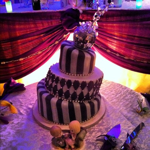 Leaning tower of Cake! The beautiful wedding cake from last night! I love that the wedding theme colour was purple. (: absolutely BEAUTIFUL! #wedding #celebration #cake #congrats  (Taken with Instagram)
