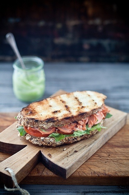 Grilled salmon sandwich with pesto & avocado spread