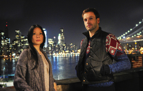 "Quite a few people have already said that Elementary's Holmes and Watson have terrible fashion sense. To my eyes, it's more like Holmes has no fashion sense — as in, he literally does not care what he wears — and Joan Watson is quite stylish. Of course, Joan's collection of loose, drapey skirts and cardigans would look absolutely terrible on most people who don't have the build and cheekbones of Lucy Liu, but such is life when it comes to style. Personally, I love her Matrix-esque fishnet sweater. — From Arthur Conan Doyle to New York City's ""Elementary"": The Costume Design of Holmes and Watson."