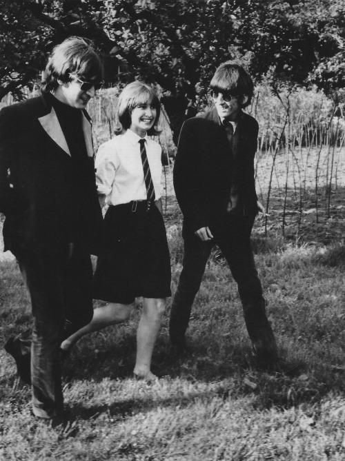"thebeatals:  John Lennon and George Harrison with a fan who snuck on the set of ""Paperback Writer"""
