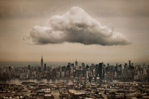 "jonathanmoore:  Midtown Cloud  ""I snapped this from the window seat as my plane was approaching LaGuardia Airport. The cloud is over Manhattan, while Brooklyn and Queens are visibile in the foreground, separated by Newtown Creek.""  Captured by Jeff Weston"
