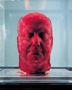 wanweird-of-an-argonaut:  This is Marc Quinn's most famous piece of work, Self, made using 4.5 litres of his own blood, which was slowly extracted from his body over a period of five months and frozen in a cast of his face. Quinn has been making these roughly every five years since 1991, and each one must be maintained carefully in fridges. The fragility of the media means exhibiting is difficult - the head has to be placed into a glass case which is chilled from underneath. It reminds the audience of the fragility of existence and the precise conditions necessary for the flourishing of life.