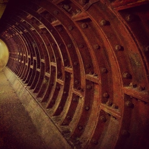 Strengthened •  Section close up • #greenwichfoottunnel #islandgardens #northend #towerhamlets #eastend #eastlondon #london #england #greatbritain #unitedkingdom #steel #concrete #iron #innerlining #bombdamaged #isleofdogs  #rust #1902 #underground #underneath #riverthames #2012 #july #earlybird #lux  (Taken with Instagram at Greenwich Foot Tunnel)