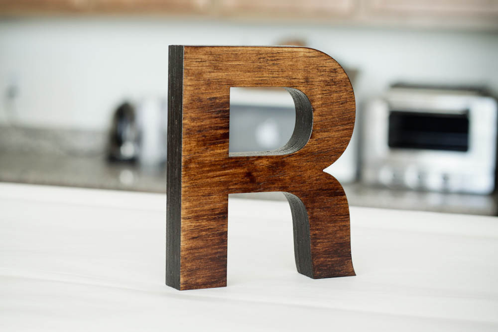 A capital R, hot off the laser cutter.