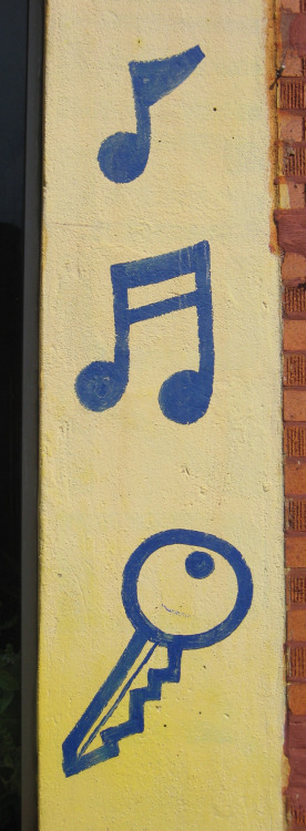 Hand-painted signage for music and keys, photographed today in Chicago's Pilsen neighborhood.
