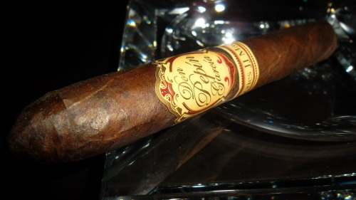 """Don Pepin Garcia, Series JJ Maduro"" Belicoso (5.3/4x52) CC Rating:92 This cigar had a dark chocolate colored oily wrapper with no tooth and very small veins. The construction overall was very impressive. The pre lit aroma consisted of tobacco and faint barnyard and chocolate notes. The ash was a dark grey color and the burn showed no issues for the entire stick. The draw was on the loose side and provided tons of rich and oily medium to full bodied smoke. The first third provided flavors of cocoa notes and a big pepper blast on the draw which would continue with the same flavors into the finish. The smoke was very creamy and filled with flavor. Nearing the second third, the pepper blast faded down to a nice pepper kick on the draw. The other draw flavors consisted of the pepper mentioned accompanied by a nice semi sweet coffee and chocolate flavor. The finish consisted of creamy leather and coffee. The blend of this cigar really blew me away! The second third produced flavors of creamy chocolate and leather notes on the draw with caramel and faint pepper and leather on the finish. Reaching the halfway point, I had to tap the ash due to the fact that it was flowering and becoming a little flakey. Up until that point the ash was holding on beautifully! Just past the halfway point, the draw flavors consisted of creamy coffee and big cocoa notes. The finish consisted of creamy black coffee and faint pepper and leather notes. The final third continued to show the same amazing blend flavors! The draw consisted of black coffee and cocoa notes with the finish consisting of coffee and creamy cocoa with faint pepper and leather notes. This cigar really impressed me considering the price you can purchase them for at various locations. The flavors were amazing and the overall construction and experience was great! Try the Series JJ Maduro!"
