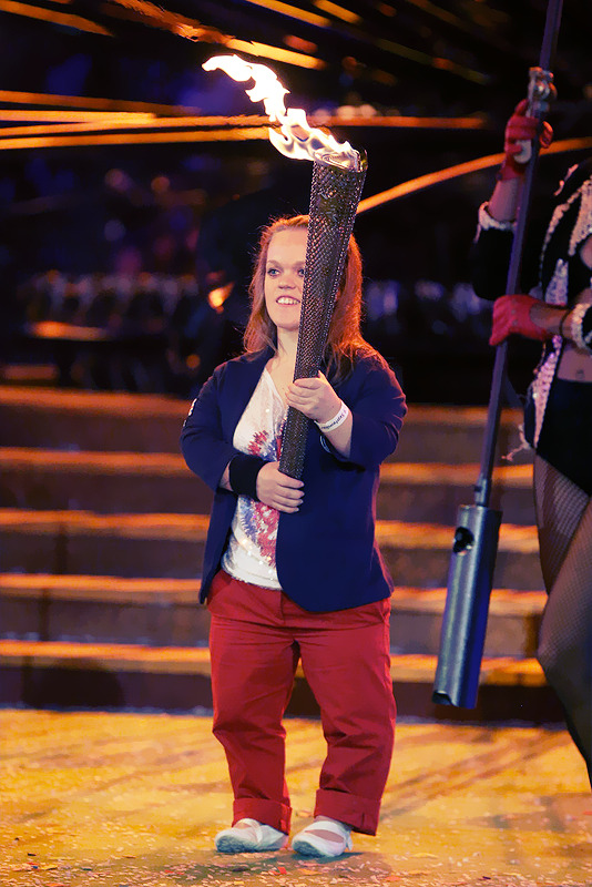 Swimmer Eleanor Simmonds lights a torch from the flame of the Paralympic cauldron as it is extinguished during the closing ceremony Photo by Peter Macdiarmid