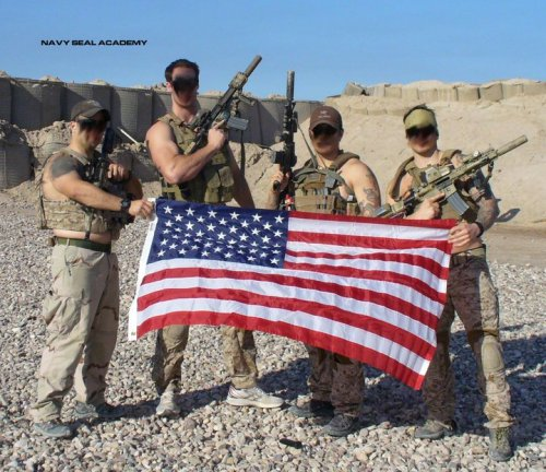 SEALs holding the greatest flag on Earth.