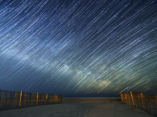 nationalgeographicmagazine:  Star Trails, New JerseyPhotograph by Jack Fusco, Your ShotTaken on April 19, 2012, in Strathmere, New Jersey. These star trails show the Milky Way rising over the Atlantic Ocean. Download Wallpaper (1600 x 1200 pixels)