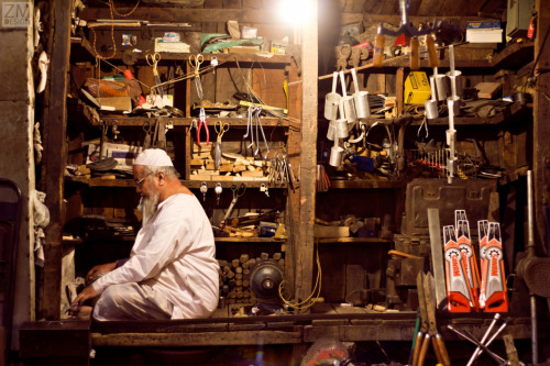 A shopkeeper prays in his little hardware store in Hyderabad India.