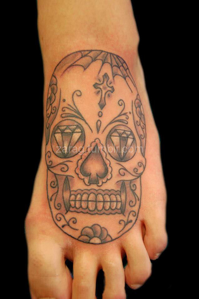 Sugar skull I did recently on a foot. The photo makes it look a little wonky, but I was actually pretty happy with this.Done by myself @ Heaven 'n' Hell Tattoos in Falkirk.http://www.facebook.com/zara.g.tattooist