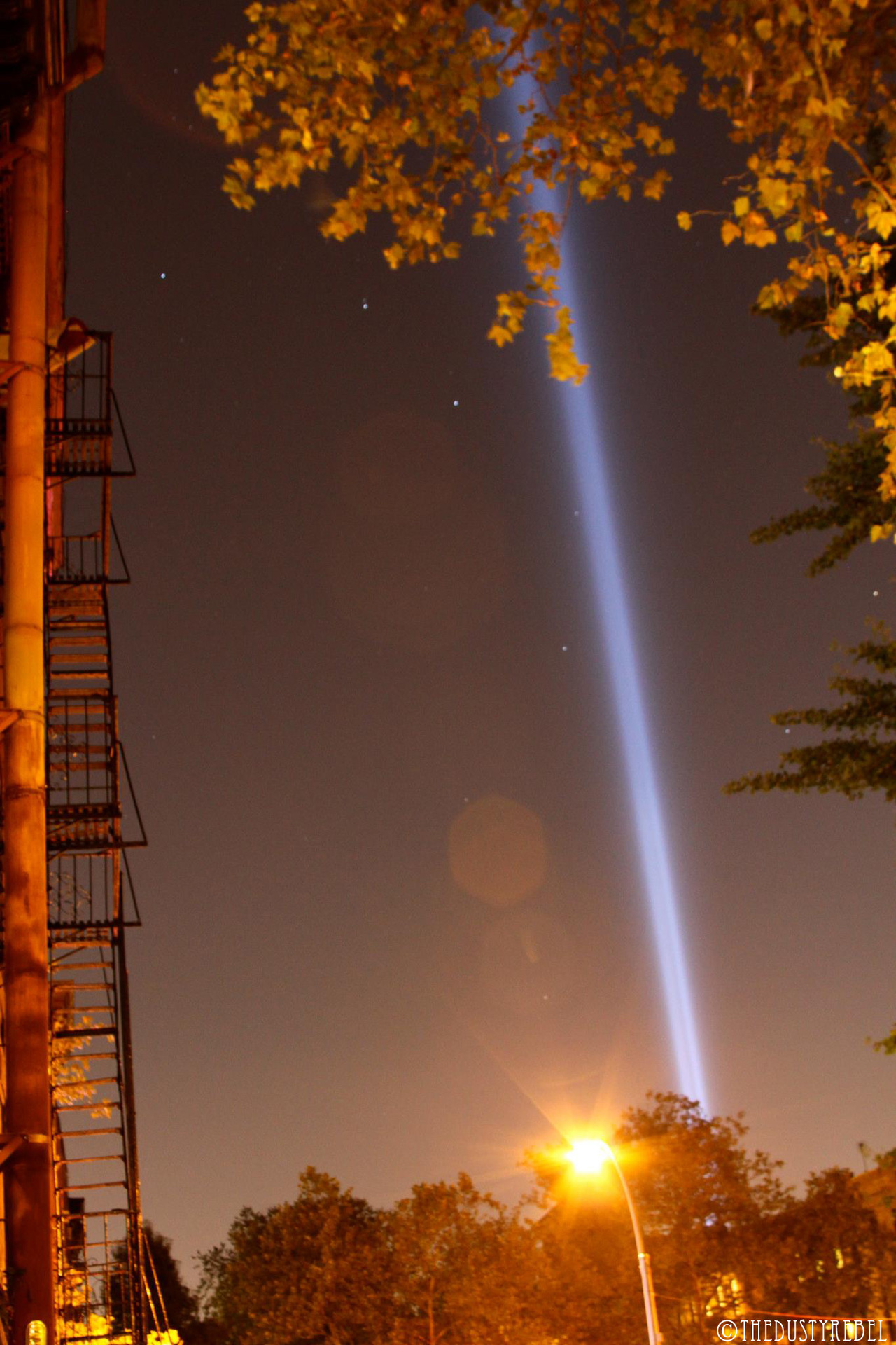 TRIBUTE IN LIGHT Every year since 2002 the Municipal Art Society of NYC  (MAS) has beamed the Tribute Lights into the sky on September 11th. The lights reach 4 miles into the sky, echoing the shape and orientation of the Twin Towers. They say it's the strongest shaft of light ever projected from earth into the night sky. Tribute in Lights was designed by John Bennett, Gustavo Bonevardi, Richard Nash Gould, Julian Laverdiere and Paul Myoda with lighting consultant Paul Marantz; all brought together by MAS & Creative Time.  Here they are, shot shining through the The Big Dipper. Photographer, TheDustyRebel. thedustyrebel:  Tribute in Light & The Big Dipper Park Slope, Brooklyn