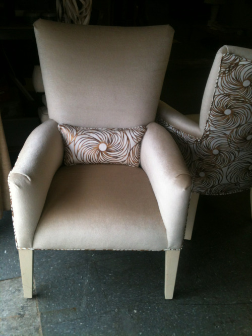 Pair of side chairs in mohair velvet and something extra—Scalamande.  The before shot.