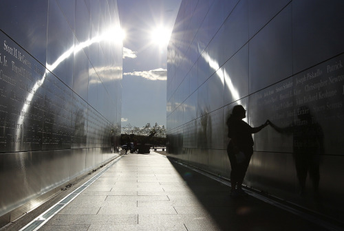 "Photo of the Day: A woman touches the wall at the ""Empty Sky"" memorial dedicated to the victims of the attack on the World Trade Center at Liberty State Park in Jersey City. (Photo: REUTERS/Gary Hershorn)"