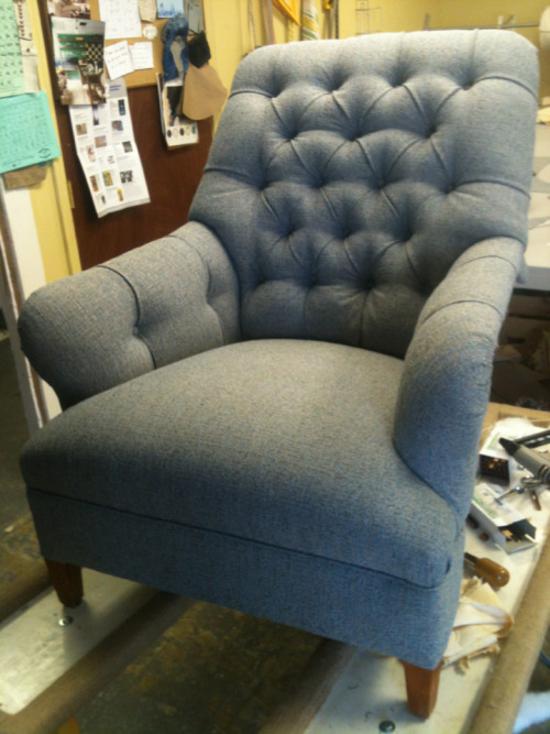 One of two button tufted arm chairs.  The before shot.