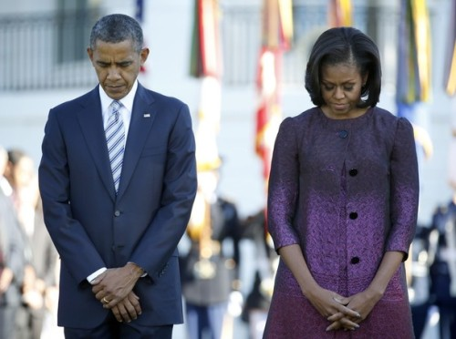 President Obama and first lady Michelle Obama participate in a moment of silence on the South Lawn of the White House September 11, 2012