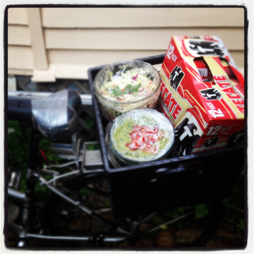 Transporting a twelve-pack of beer, guacamole, carnitas, and coleslaw by bike made for an interesting start to last night's taco gathering.