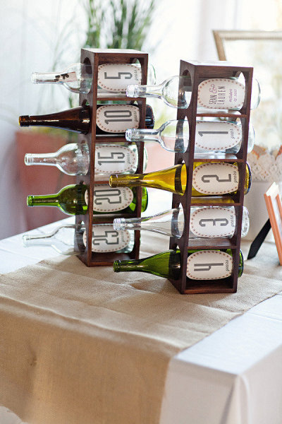 Each bottle represents a year of your marriage. Guests write notes and slip in whatever year bottle they want. As a couple, open it on that year's anniversary.