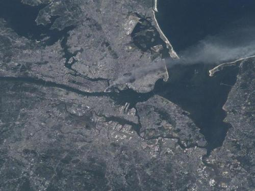 buzzfeed:  Chilling photo of NYC on September 11th, 2001 taken from space.  Never noticed how much Brooklyn, Manhattan, and that little bit of New Jersey together at this angle look like a skull eating Staten Island. Huh.