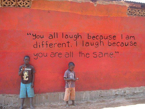 """You all laugh because I am different. I laugh because yo are allt he same."" This is a quote from Korn's singer Jonathan Davis (I looked it up!). I'm not sure who painted this and where so fill us in if you know! Thanks to www.facebook.com/pages/Streetart-retards/178370992175715 for this!"