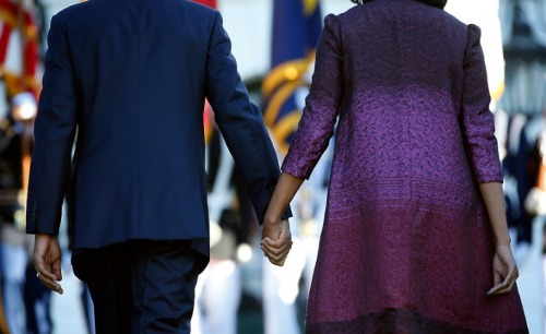 First Lady Michelle Obama and Pres. Obama observe a moment of silence in remembrance of the victims of 9/11.