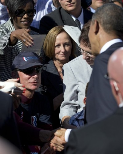 apsies:  President Obama shakes hands with a man wearing a Romney hat during a ceremony at the Pentagon Memorial, Sept. 11, 2012.  The President sees your partisan ploy and raises you one bipartisan handshake.