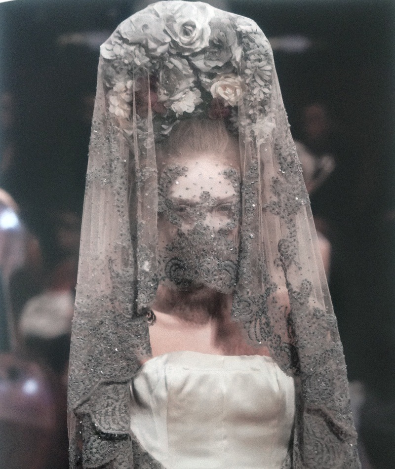 "deprincessed:  Alexander McQueen S/S 2007 ""This look from the Spring/Summer 2007 collection is McQueen's take on a Victorian bride. Though she is clad in white with clear bridal suggestions, the antique quality of her veil, the ashen color of which seems to coat the lace like a film of dust accumulated over years of neglect, suggests a general sentiment of something sinister lurking beneath the bridal veil."" taken from Alexander McQueen: Genius Of A Generation"