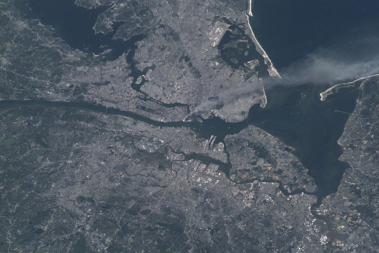 "New York City as seen by NASA Astronaut Frank Culbertson on the International Space Station, September 11th, 2001.  ""It's horrible to see smoke pouring from wounds in your own country from such a fantastic vantage point. The dichotomy of being on a spacecraft dedicated to improving life on the earth and watching life being destroyed by such willful, terrible acts is jolting to the psyche, no matter who you are.""—Commander Frank Culbertson, Expedition 3 (image credit: NASA/Frank Culbertson)"