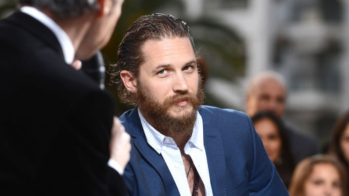 "An interview with Tom Hardy from the Swedish paper Dagens Nyheter. This time translated by me! I love seeing him get some press in Sweden. Best quote: ""My biggest talent is that I'm me."" Trademark Hardy. :D  After Inception, The Dark Knight Rises and Tinker Tailor Soldier Spy, the Brit Tom Hardy is one of Hollywood's hottest items. In John Hillcoat's Lawless he plays a bootlegging … matriarch. At drama school in London, Tom Hardy and his class mates used to compete about who could imitate Gary Oldman the best. Hardy claims to not be the sort who's easily impressed and who's usually star struck. But when he stood face to face with his idol during the filming of Tomas Alfredson's Tinker Tailor Soldier Spy, he was seriously tongue-tied. The scene where the traumatised MI6-puppy Ricki Tarr cries on George Smiley's sofa had to be reshot several times. ""I've stolen everything from Gary Oldman,"" Tom Hardy admits. Furthermore, it was Tom Hardy who made Gary Oldman accept a supporting role as a gangster boss in John Hillcoat's Lawless. Oldman is well and good, but this time it's his disciple who steals the show. Tom Hardy is the main draw in an otherwise rather mediocre film based on Matt Bondurant's novel about his relatives, The Wettest County in the World (2008), a violent tale of a tough family of bootleggers during Prohibition in the American Midwest. Hardy plays the middle brother Forrest Bondurant among three lawless redneck brothers who are trying to survive the depression of the 30's and a sadistic sheriff (Guy Pearce) in Virginia. ""You could call this a wangster-film, a mix of western and gangster. Lawless is like The Waltons on acid. I myself was brought up watching Vietnam war films like Apocalypse Now and The Platoon, they were my westerns,"" Tom Hardy smiled when I met him in Cannes this spring. Hollywoods latest hot item met part of the world press in torn jeans and and a green t-shirt with the text Support Our Troops which can't hide all the tattoos on his upper arms. And a wild beard for his role as the road warrior Max Rockatansky who's making a come back in George Miller's Mad Max 4: Fury Road (2013). Hardy is one of those actors who always manages to transform himself completely for each new character. As the Batman-villain Bane he even manages to carve out a character, in spite of wearing a huge toaster glued to his face. The role of Forrest was also a first class transformation. ""Sure, I'd love to be Clint Eastwood, but I'll never be like him. I'm from East Sheen, London, and this is the US so right there's an apparent physical transformation,"" Tom Hardy explains and begins a long tirade about how he ""hotwired"" his character, getting past the director's instruction. ""They wanted Forrest to be a hard macho guy, but I wanted him to be a woman. Forrest is a matriarch - not a patriarch. Sure, I'll put on Clint's cowboy hat and put a cigar in my mouth and the muscles were already there for The Dark Knight Rises. But Forrest is the mother of his brothers, he acts like a tough guy, but he isn't tough - he's realised he has to take care of his family and be loving if you want to survive,"" Hardy explains. As opposed to Forrest, Tom Hardy doesn't want to have anything to do with alcohol or drugs. Anymore. He's been free from alcohol and drugs for ten years. The only experimentation he does these days is on the job. ""My biggest talent is that I'm me. That I'm there will of course mean that I'll put something of myself into my character. Everytime I create a new character I'm always looking for the right hook. And everytime I feel the same weird dread before the first day of filming. I'm fidgeting like a worm on a fish hook. I'm freaking out. I'm often overly ambitious, but it mostly ends up with me not working seriously until the cameras are rolling,"" says Tom Hardy who's in a joking frame of mind. When his co-actor Guy Pearce, sitting next to him, says that he chooses work on the basis of ""the right combination of script, character and director"", Hardy adds: ""And the number of zeros on the paycheck!"" Asking if playing Bane in The Dark Knight Rises has changed his life, Hardy answers: ""Sure! And most of all it will change YOUR life!"" Hardy becomes significantly more serious when he's asked to comment on working with Tomas Alfredson in Tinker Tailor Soldier Spy. ""There's no one I'm more enthusiastic about than Tomas Alfredson, he's one of the most delightful people and artists I've ever met. It was a pleasure working with him, or rather working for. I'm hoping to work WITH him one day when I've grown up,"" Hardy says with a smile. In contrast to many of his Hollywood-colleagues he seems aware of living in a dream-world. Hardy is happy to talk about his charities, for example being an ambassador for Prins Charles' trust fond for disadvantaged youth and as an activitist in collecting money for disabled soldiers from Iraq and Afghanistan. ""It's a cruel world out there, it's important to remember that Hollywood is just a sheltered world. The worst that can happen is that someone criticises your acting, but no one will shoot your brains out for real."""