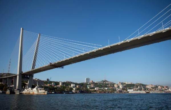 Russia's got their own Bridge to Nowhere, but at what cost? http://bit.ly/QhtuD5 From Anna Nemtsova: The $1 billion bridge has the highest pylons of any in the world; it was built to reach to an island with fewer than 5,000 people. Image by Martin Bureau/AFP/Getty Images. Russia, 2012.