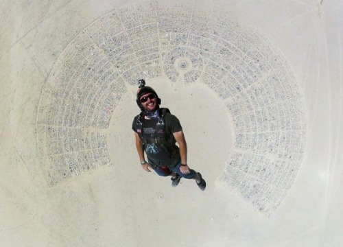 sirmitchell:  Skydiver above Burning Man. What a shot.  [ reddit ]  Whoah.
