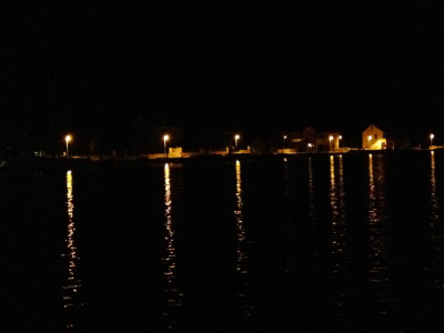 Taking the boat home after dinner. The lights stretching out on the water look like the tentacles of the 300 wee calimari pieces in my belly.