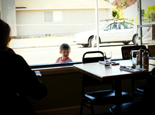 A boy looks through the window at Toast on SE 52nd Avenue in Southeast Portland on Tuesday, Sept. 11, 2012.