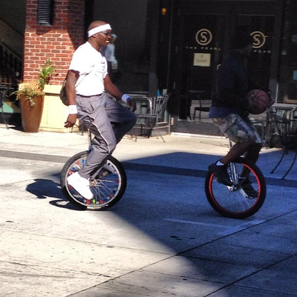 Black guys, unicycles, headbands, a basketball, and du-rags. #keepportlandweird #pdx  (Taken with Instagram at Sisters Coffee Company)